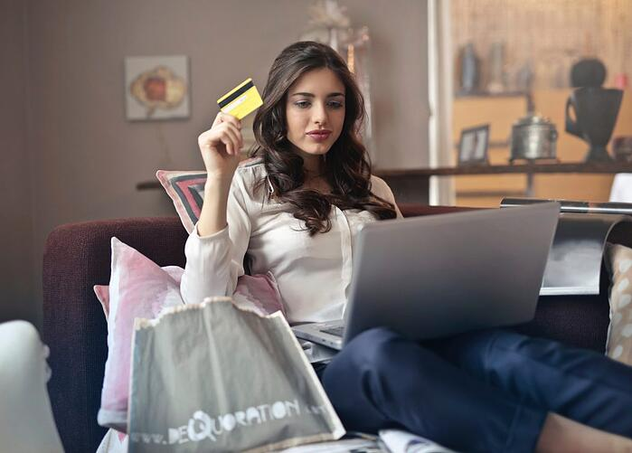 A woman shopper using credit card for online shopping on eCommerce website
