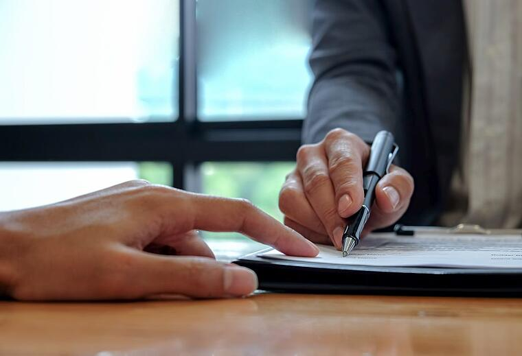 Customer and SaaS sales manager signing a contract for SaaS product