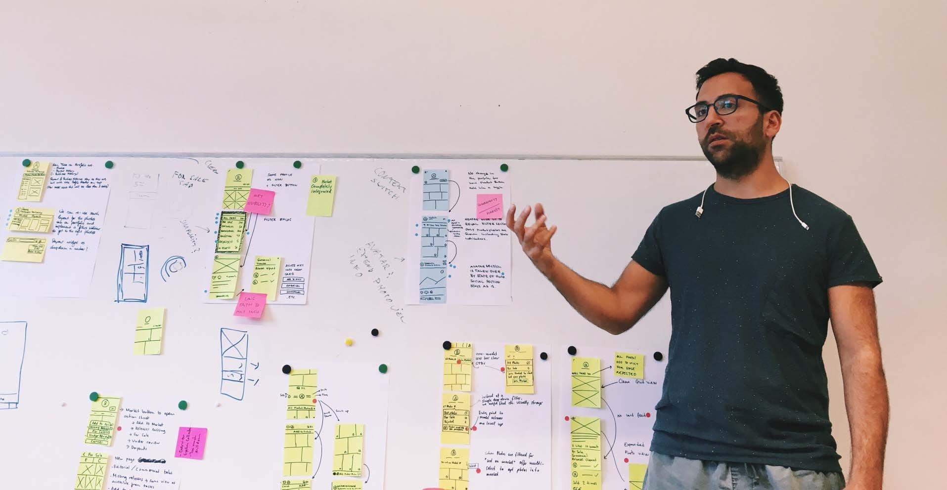man-presenting-at-whiteboard_t20_NQoa0n